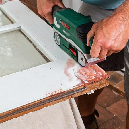 6. Once dry, sand the repaired area smooth with an orbital sander.
