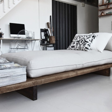 HOME-DZINE | DIY Furniture Ideas - The design for the Day Bed is super simple: long wooden planks are mounted on simple plank legs of horizontal planks to provide support for the comfortable ready-made futon that serves as seating and a guest bed when needed.
