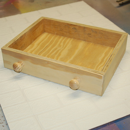 9. Assemble the drawer by gluing the sides, front and back onto the base.