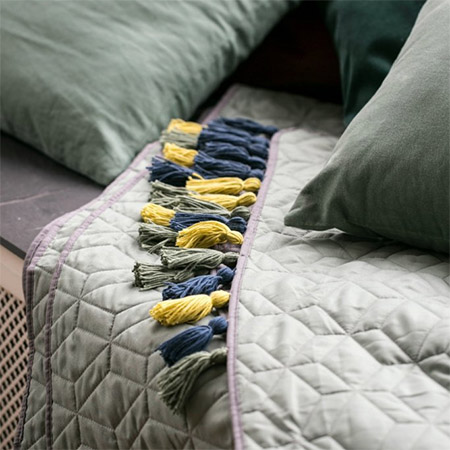 Give last years throws and bedding an instant update with colourful tassels.