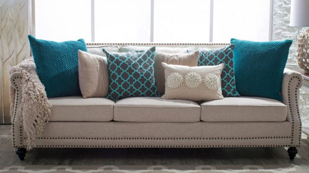 Tie colours into the overall scheme by choosing cushions with complementary colours - or hues from the same colour swatch.