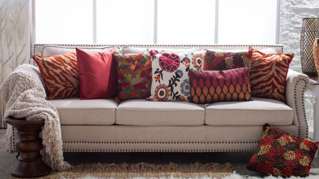 Earth-toned colours and warm reds spice up a living room sofa and introduce a cosy atmosphere to the room.
