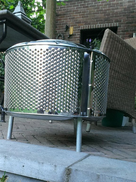 This simple design from Instructables is super easy to make, and all you need is a stainless steel drum taken from a broken washing machine