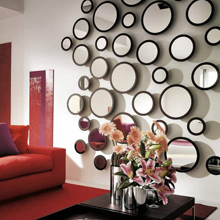 Mirrors are a wonderfully affordable way to bounce light around a room and create the illusion of space