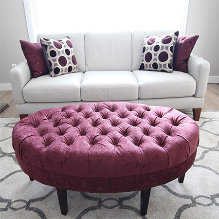 This beautiful tufted ottoman | stool was reupholstered and given a new lease on life