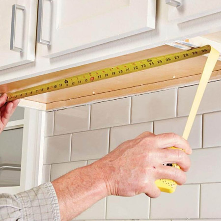Measure the length and width of your wall cabinet.