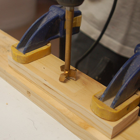 HOME-DZINE | Upholstery Projects - Use a MAD, Forstner or spade bit (same diameter as chrome pipe) to make a hole to half the depth of one of the blocks.