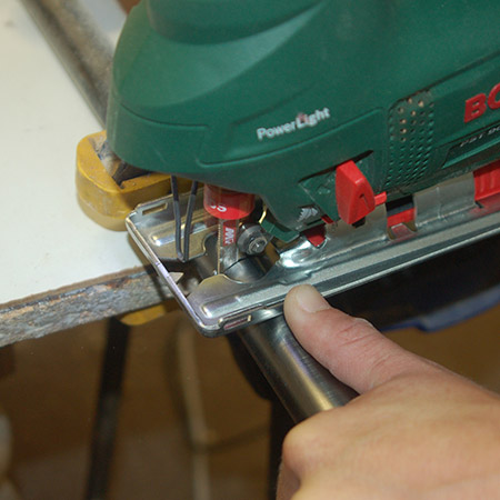 HOME-DZINE | Upholstery Projects - Clamp the pipe to your work bench and use a jigsaw and steel jigsaw blade to cut a length of pipe - 120 to 150mm should be sufficient.