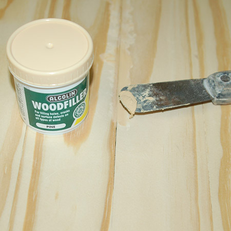 Choose a tinted wood filler that matches how your table will be finished if you are staining. For this table I'm using pine wood filler. Let dry and then sand smooth