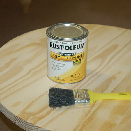 You have several options for finishing the occasional table. I'm applying Rust-Oleum Ultimate Polyurethane in natural matte. I don't want the table to go yellow after sealing, and I also want the table to look at natural as possible.