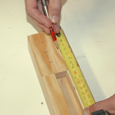 4. On the top, mark out for drilling the pen or pencils.