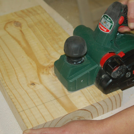 1. To make the curved seat you're going to use a Planer. Set the cutting depth at 2mm and start 50mm in from the end on one side of the seat – working towards the centre – and then to the other side.