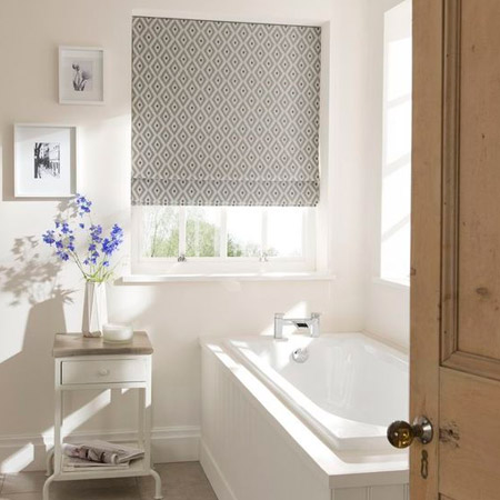 The experts at Finishing Touches can help you choose the perfect window treatment for your bathroom.