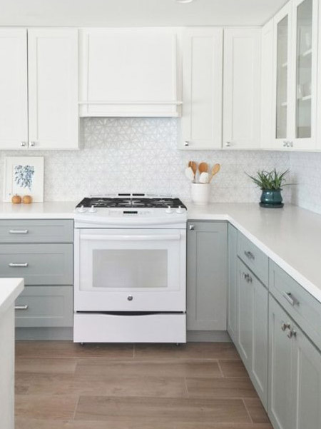 The two-tone kitchen trend is all about painting the upper and lower cabinetry in two different hues, generally from the same colour swatch but with the top being far lighter than the base