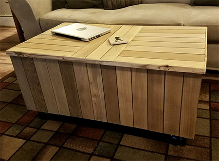 This reclaimed pallet wood coffee table seen on instructables.com vhas a lift-up top that reveals a large storage compartment below.
