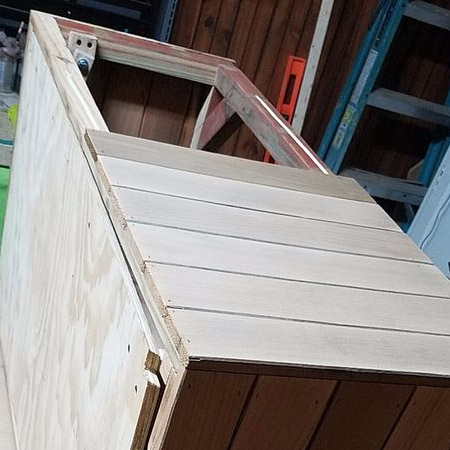Secure the planks onto the outside of the frame using wood glue and a pneumatic nailer or hammer and panel pins