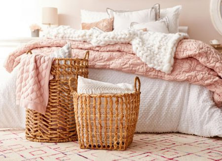 Contain clutter in a bedroom with attractive storage. Baskets are a versatile alternative to bulky furniture for the smaller bedroom, and you can place them wherever they're needed.