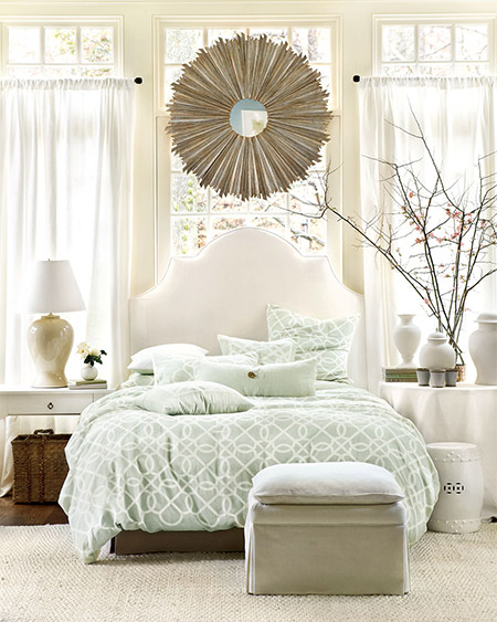 When designing your home or moving into a new home, bedrooms don't always have room to be fussy about where to put the bed. Sometimes placing the bed in front of a window works perfectly!