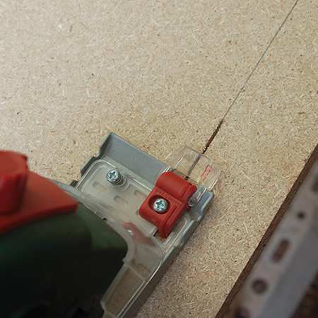Setting up the PKS 16 is as easy as plugging in. Once you've drawn a cutting line on the board, switch on and use the guide at the front of the tool to cut perfectly straight lines.