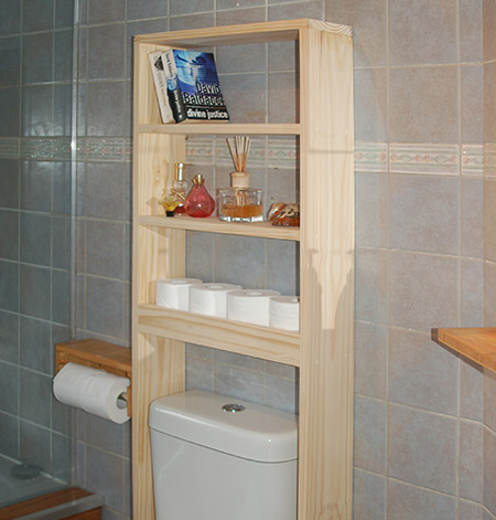 An above-toilet shelf unit is a great way to add extra storage to a small or cramped bathroom.