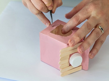 HOME-DZINE | Craft Ideas - Draw an opening at the front and back of the container and cut this out with a craft knife. Also cut small cross shapes just below the openings.