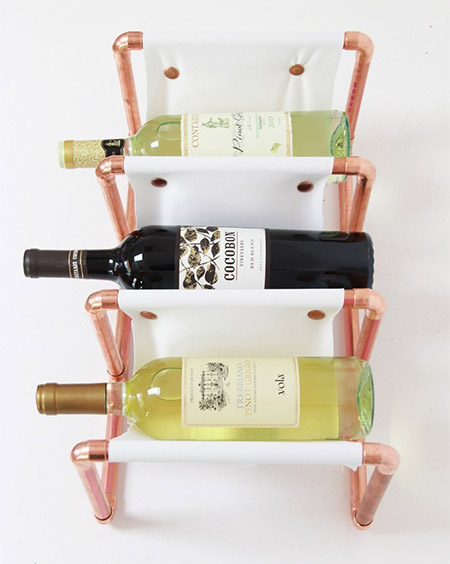 HOME-DZINE | Copper Tube DIY - The copper tube and leather wine rack by Laurel is a great example of how you can use copper tubing to make stunning, practical items for the home. The project is made using lengths of tube, copper Ts and elbows, and cut leather.
