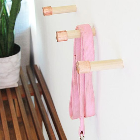 HOME-DZINE | Copper Tube DIY - Another copper tube project by Laurel is to add a copper end cap to wooden dowels to make hangers. If you don't have drywall for mounting the hangers, secure them onto a backing board to hang on the wall.