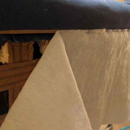 HOME-DZINE | Upholstery Projects - Before pulling the back fabric down and over the tack strip, adding a thin layer of batting on the back gives the fabric a nice flow over any straps or springs.