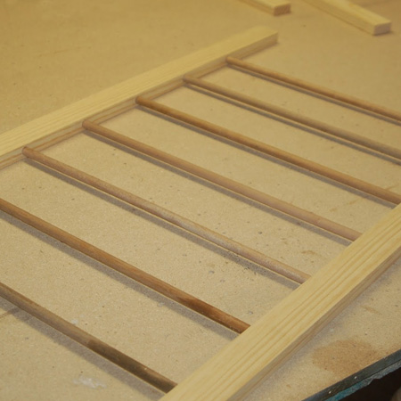add dowels to laundry drying rack