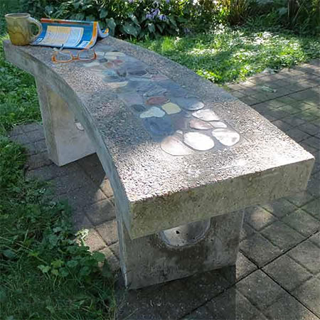 Concrete bench with pebble inlay