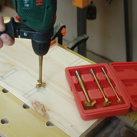 drill holes with MAD bit