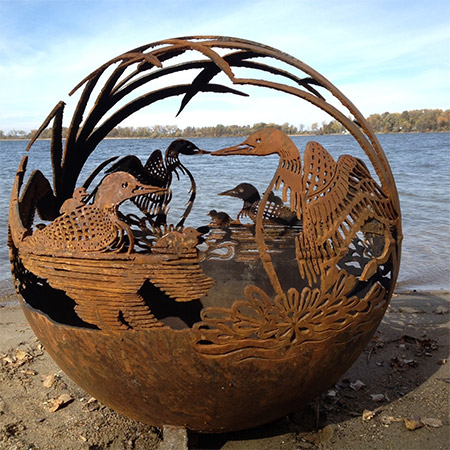 the Loon, a handcrafted steel fireglobe with a design that creates a beautiful performance with highlighted by fire