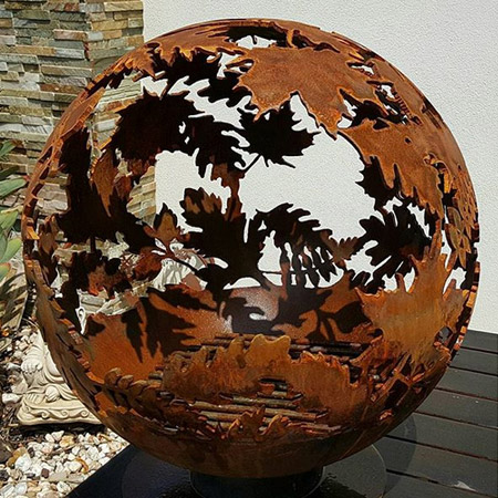 Using a plasma cutter, her designs are transferred directly onto the steel globes, to create a delicate, fairytale-like imagery.