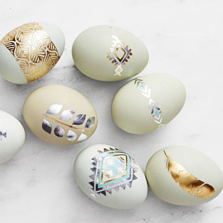 These beautiful metallic design eggs would look great in any Easter setting. Paint the eggs in muted colours and then use metallic foil to create tattoo designs.