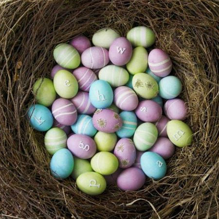 Here's another colourful Easter egg display. The eggs are dyed in lavender food colouring and then painted with white swirls. To create the swirls, wrap the eggs with an elastic band before dyeing.