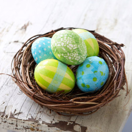 Create a colourful basket of Easter eggs by wrapping them in tissue paper. Layer on scraps of tissue paper with ModPodge and then coat with extra ModPodge to finish.