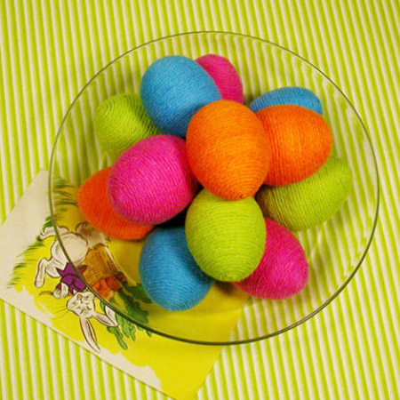 Got some yarn left over? Apply craft glue and wrap the eggs with colourful yarn.