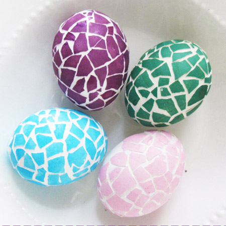 Time for something different... give Easter eggs a mosaic effect with coloured eggshells glued on the top.