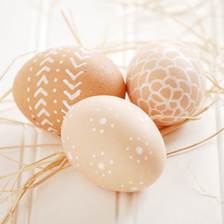 Go for a natural touch for this year's Easter eggs. Plain brown eggs are painted with unusual designs with a white paint pen.
