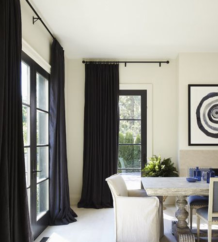 In a room with a low ceiling, add visual height by mounting the curtain track or rail at the top of the wall.