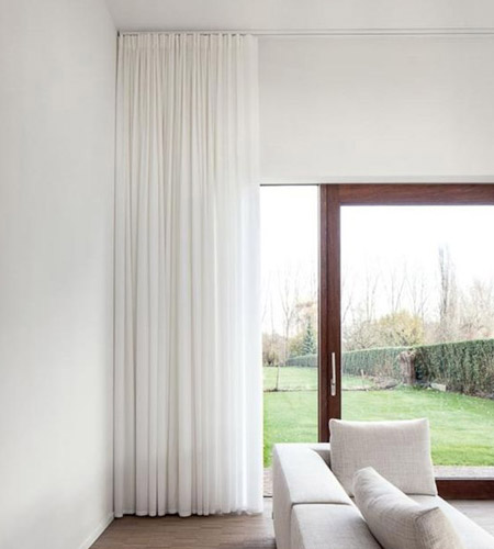 Of course, if you are looking for something a little more sophisticated, you can select a pleated curtain mounted on a slimline track above the door frame.
