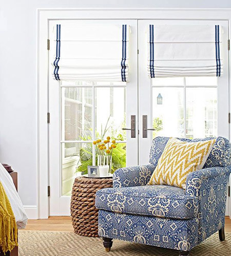 If you're not a fan of flounces and frills, you can't go wrong with simple Roman blinds as a window dressing for French doors.