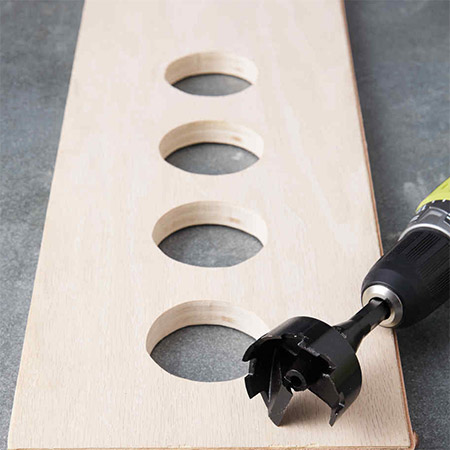 To drill small to medium holes in a shelf you can use either a spade bit, a MAD bit or a Forstner bit