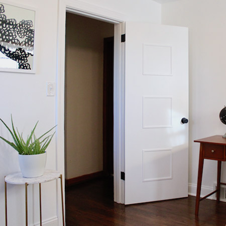 Here's an easy way to give doors a makeover with pine moulding strips and glue.