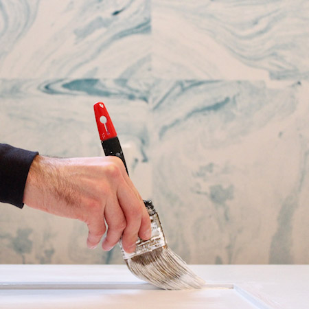 For previously painted doors, and where the surface doesn't need sanding or repair, you can apply a waterbased enamel