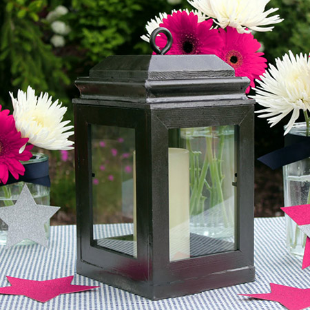 This decorative wooden lantern is perfect for dressing up a table and is cheap and easy to make if you already have some cheap wooden frames lying around.