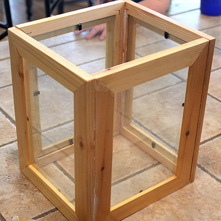This is a cheap and easy way to make your own decorative lanters, as you already have the frames with the glass inside.