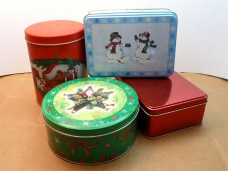 Many stores sell Christmas goods in tins, and here's a way to turn these into practical and pretty storage containers.