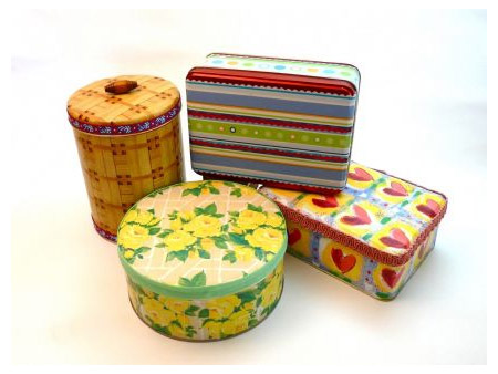 There are lots of stores that pack their Christmas goodies into tins, and we show you how to transform these tins with colourful wrapping and scrapbooking paper, to turn them into practical storage containers.