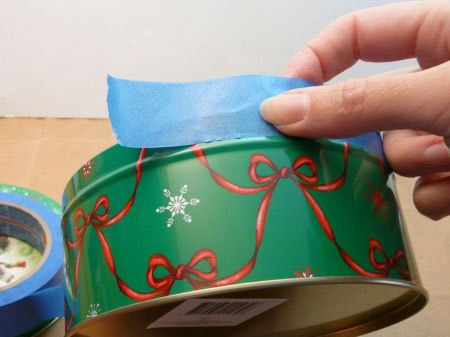 Place masking tape around the top rim of your tins